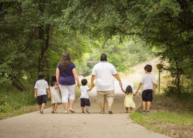 foster family walking with kiddos